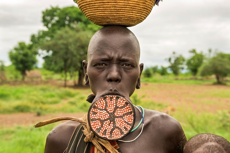 Wearing a large disc in the lower lip is considered beautiful in some parts of Ethiopia.